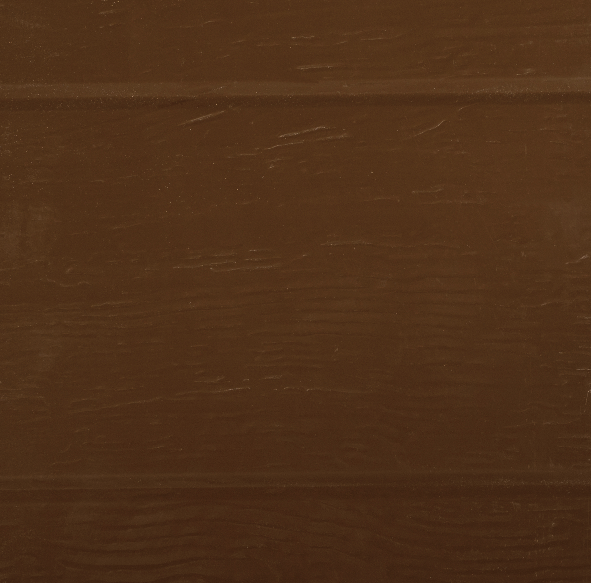 Brama garażowa K4 o ciepłej brązowej barwie, o bardzo nowoczesnym i eleganckim stylu.